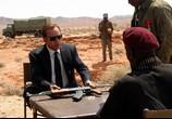 Сцена изо фильма Оружейный магнат / Lord of War (2005) Оружейный барон